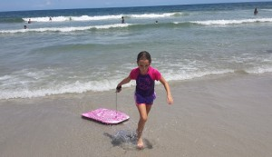 Daughter bodyboarding at the beach